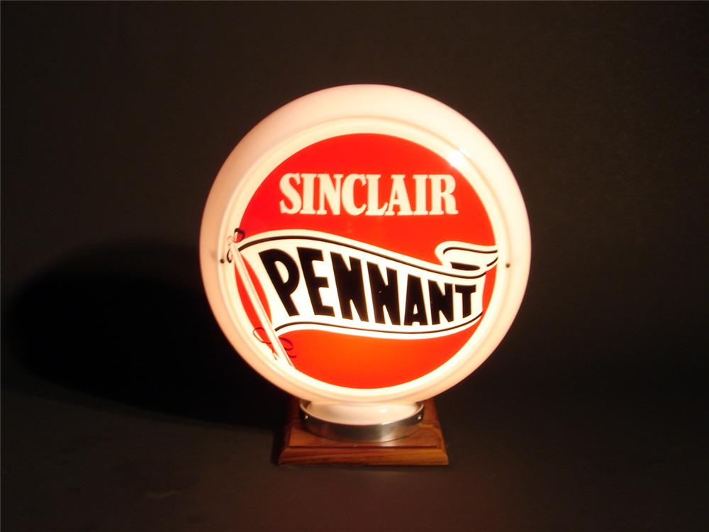 Wonderful 1950s Sinclair Pennant Gasoline narrow bodied glass gas pump globe with new old stock lenses. - Front 3/4 - 50160
