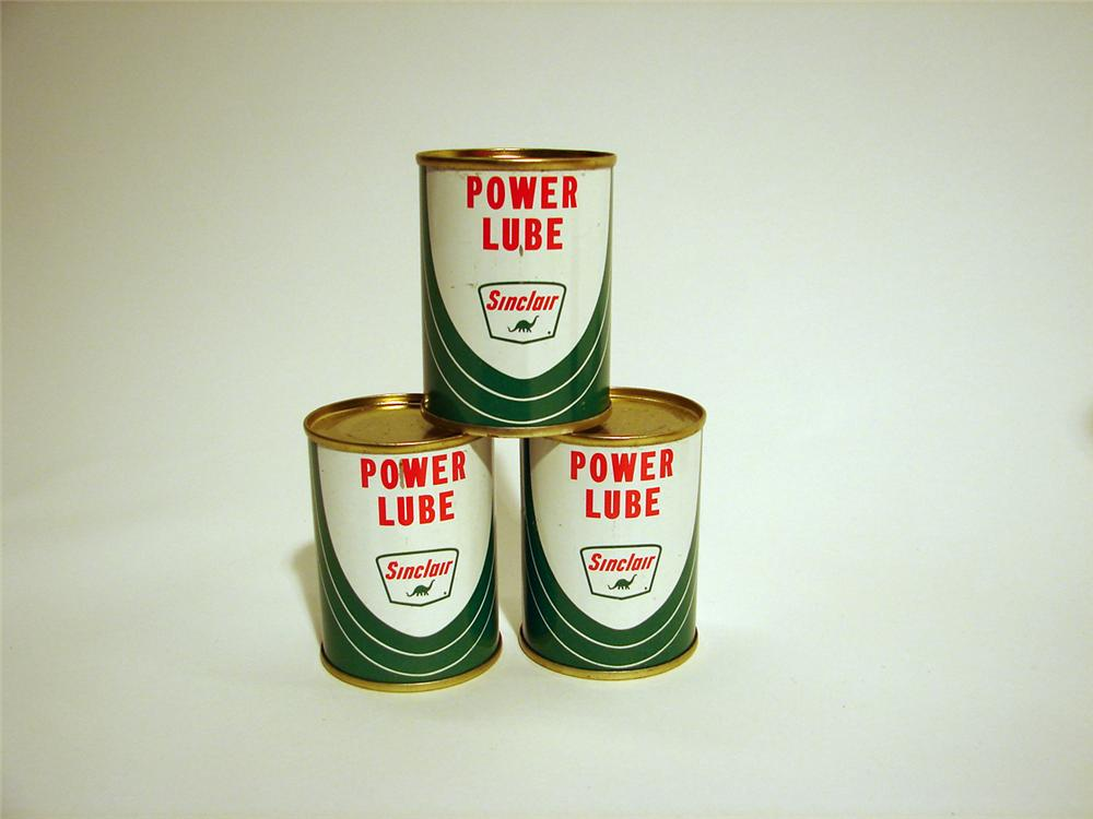 Lot of three N.O.S. 1950s Sinclair Upper Lube four ounce tins. - Front 3/4 - 50260