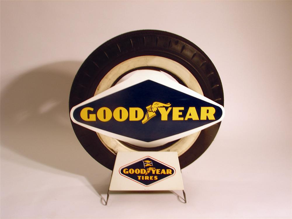 Neat 1950s Goodyear Garage display stand with two N.O.S. signs and an original tire. - Front 3/4 - 50269