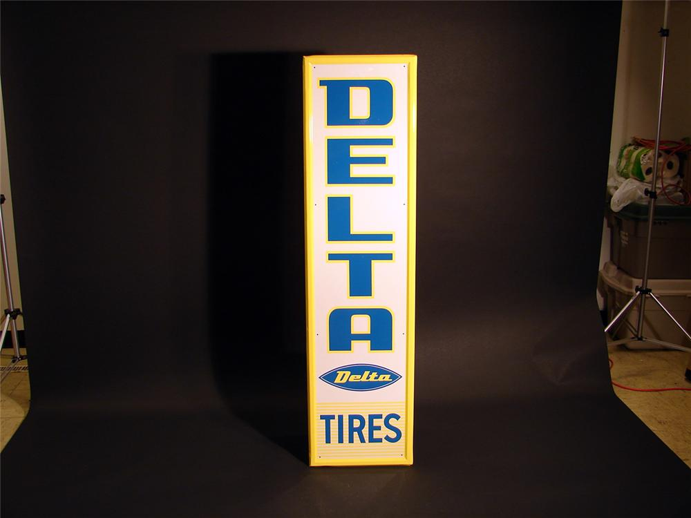N.O.S. 1960s Delta Tires vertical tin painted garage sign. - Front 3/4 - 50277