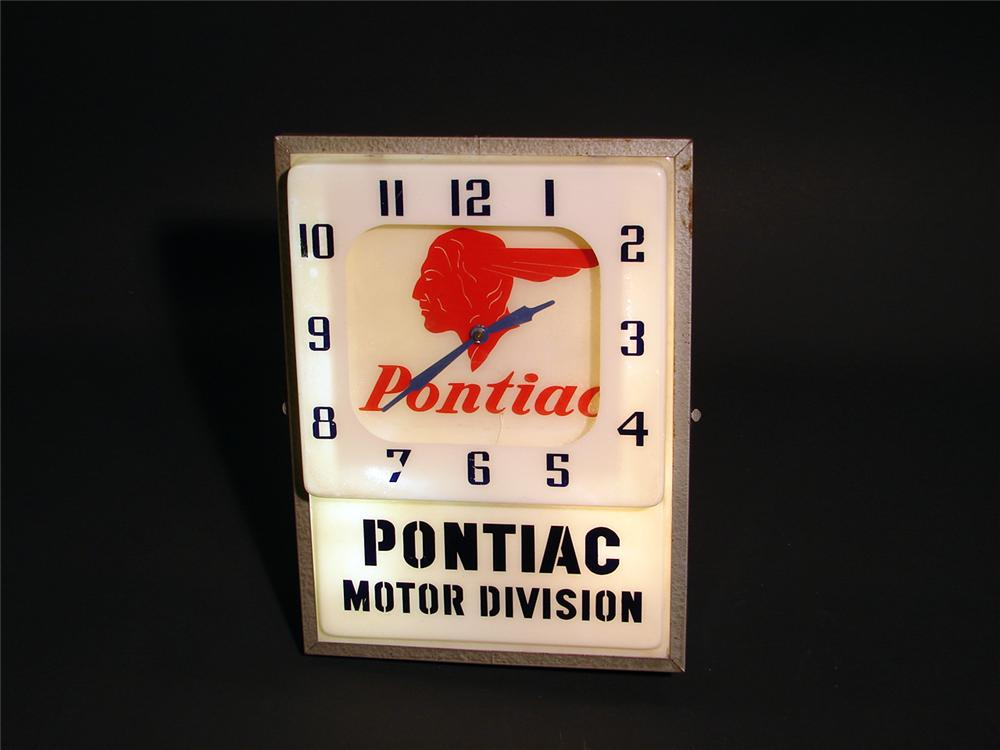Scarce 1950s Pontiac Motor Division light-up clock. - Front 3/4 - 50285