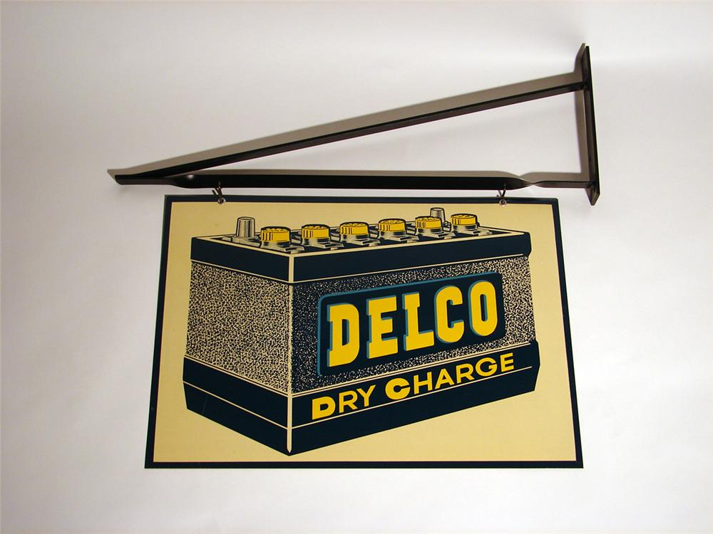 N.O.S. 1950s GM Delco Batteries double-sided tin garage sign with original hanging bracket. - Front 3/4 - 50288