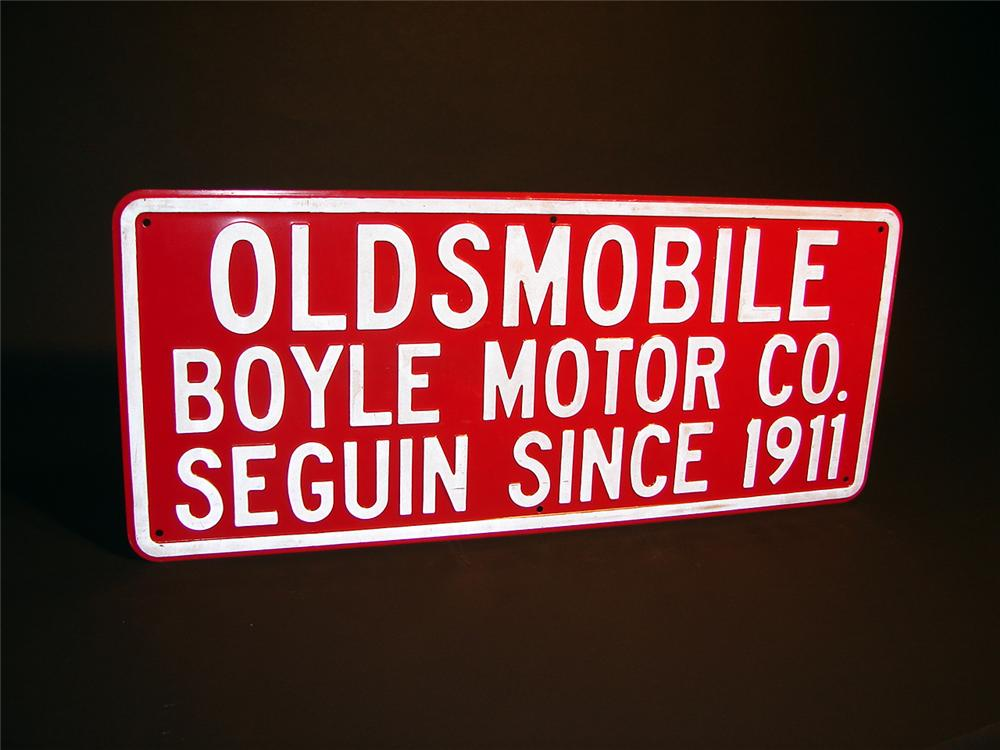 1940s Oldsmobile dealership tin sign with embossed lettering. - Front 3/4 - 50387
