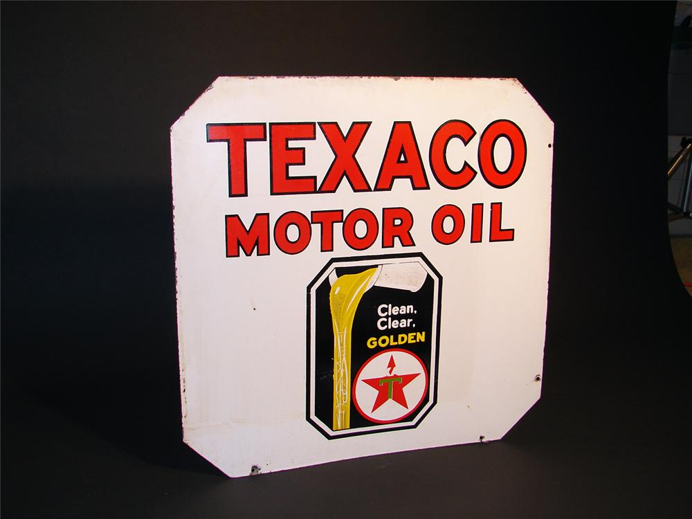 1930s Texaco Motor Oil double-sided porcelain station sign with oil pouring graphic. - Front 3/4 - 50408