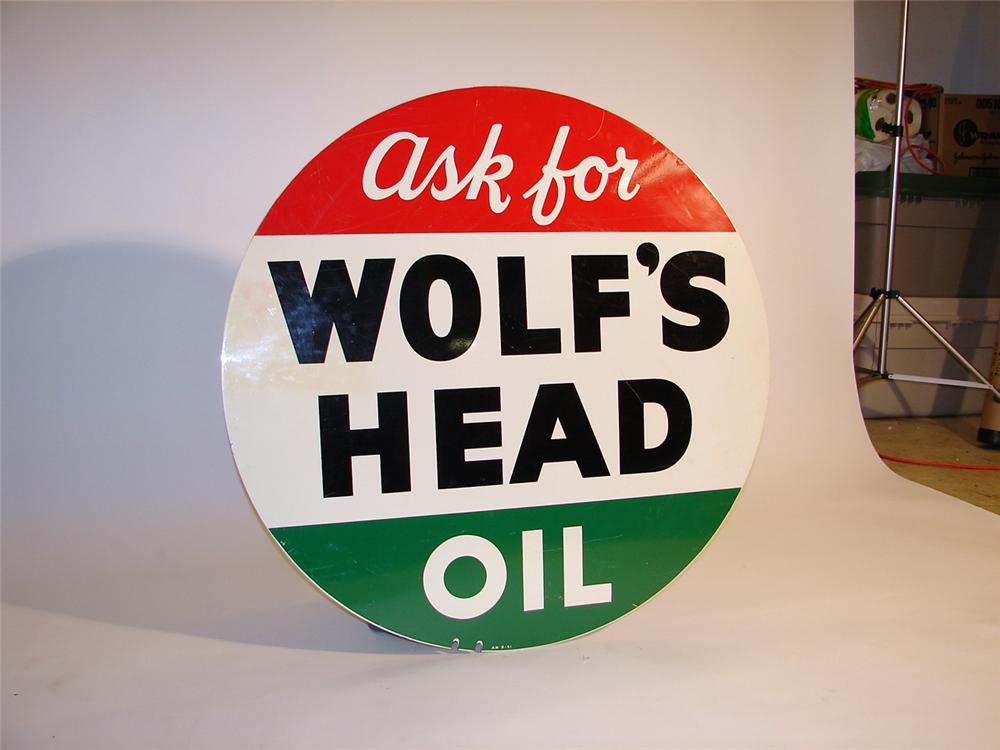 1951 Wolfs Head Motor Oil double-sided tin garage sign. - Front 3/4 - 50560
