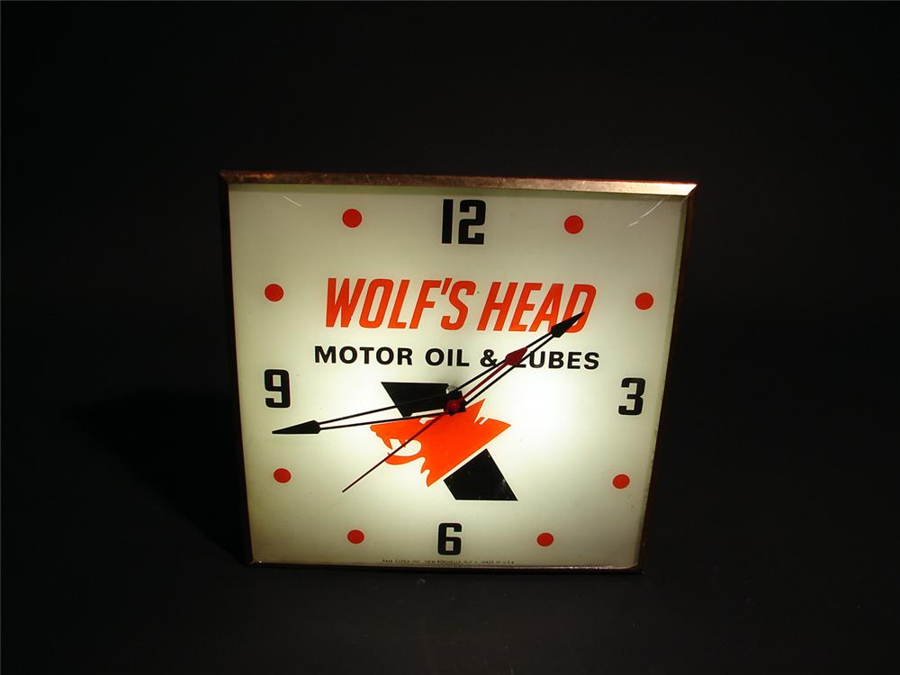 Early 60s Wolfs Head Motor Oil light-up station clock by Pam.  Lights and works well. - Front 3/4 - 50569