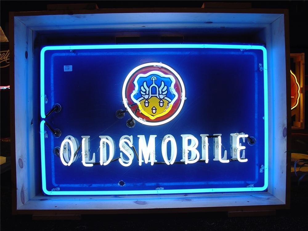 Extremely scarce 1940s Oldsmobile single-sided porcelain neon dealership sign. - Front 3/4 - 50583