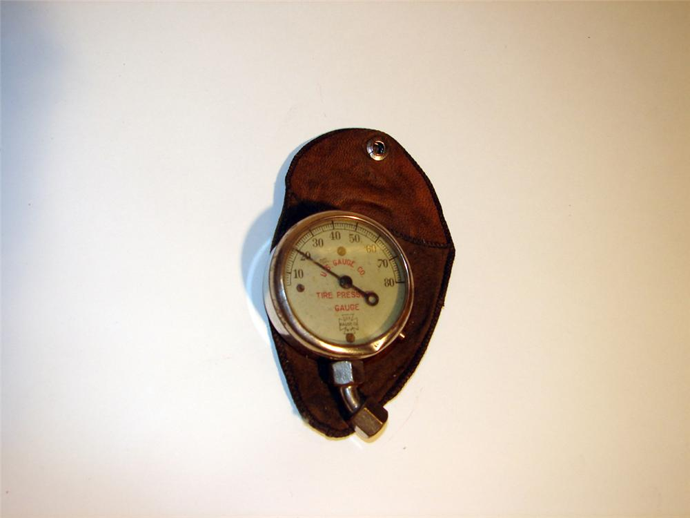 U.S. Tires balloon tires glass faced dial pressure gauge presented in original leather pouch. - Front 3/4 - 50708