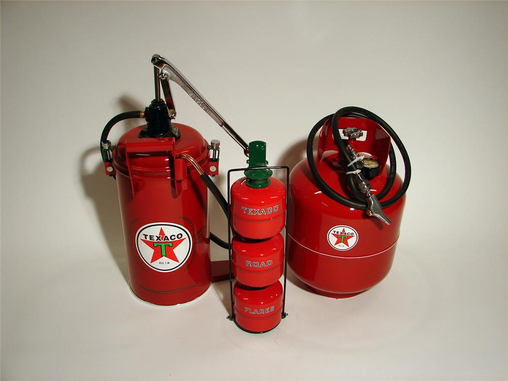 Lot of three professionally restored Texaco station service items including a high pressure hand pump greaser, air tank, and... - Front 3/4 - 50733