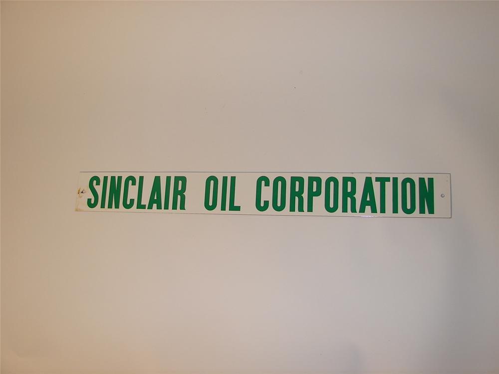 Lot #5517 - 1950s Sinclair Oil Corporation porcelain strip sign. - Front 3/4 - 62690