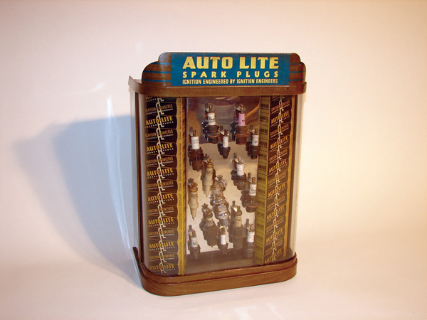 1930s Auto Lite Spark Plugs station display cabinet complete with original spark plugs. - Front 3/4 - 62850