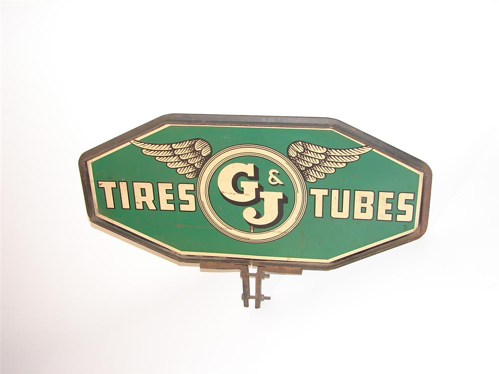 1930s G&J Tires dbl sided tin garage sign with flying tire logo. - Front 3/4 - 62863