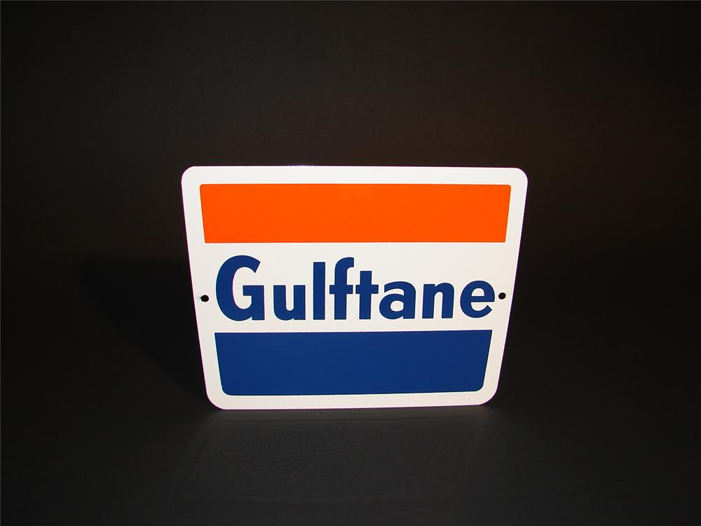 N.O.S. early 60s Gulftaine porcelain pump plate sign. - Front 3/4 - 62909