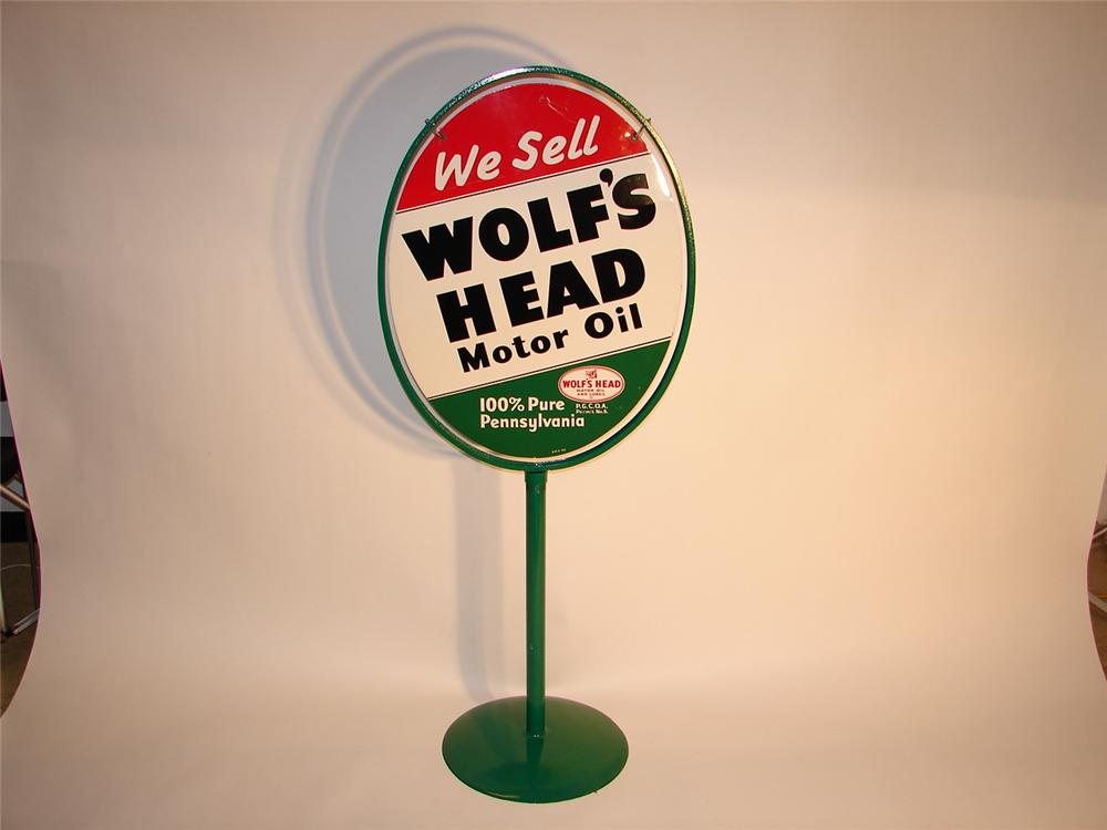 Fabulous 1953 Wolfs Head Motor Oil double-sided tin curb sign in original stand. - Front 3/4 - 62923