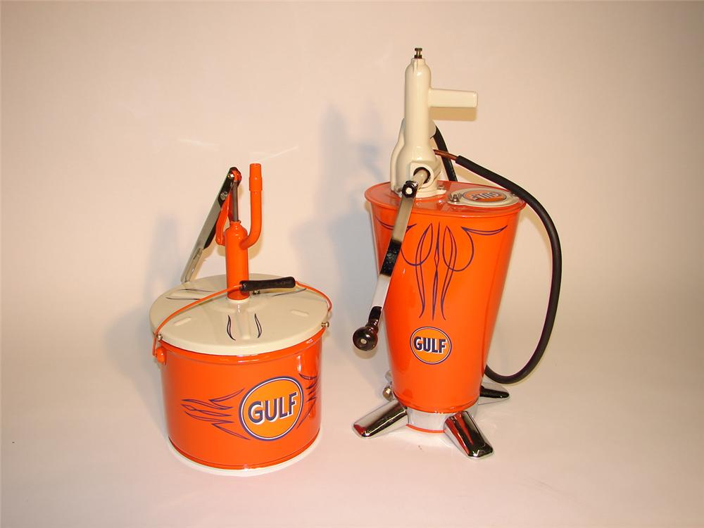 Fabulous lot of two restored Gulf pieces - 1940s trans greaser-hand crank and 1930s utility greaser. - Front 3/4 - 62948