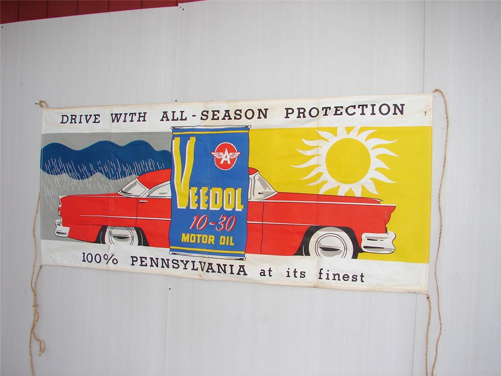 N.O.S. late 50s Veedol Motor Oil station banner with sedan depicted. - Front 3/4 - 62994