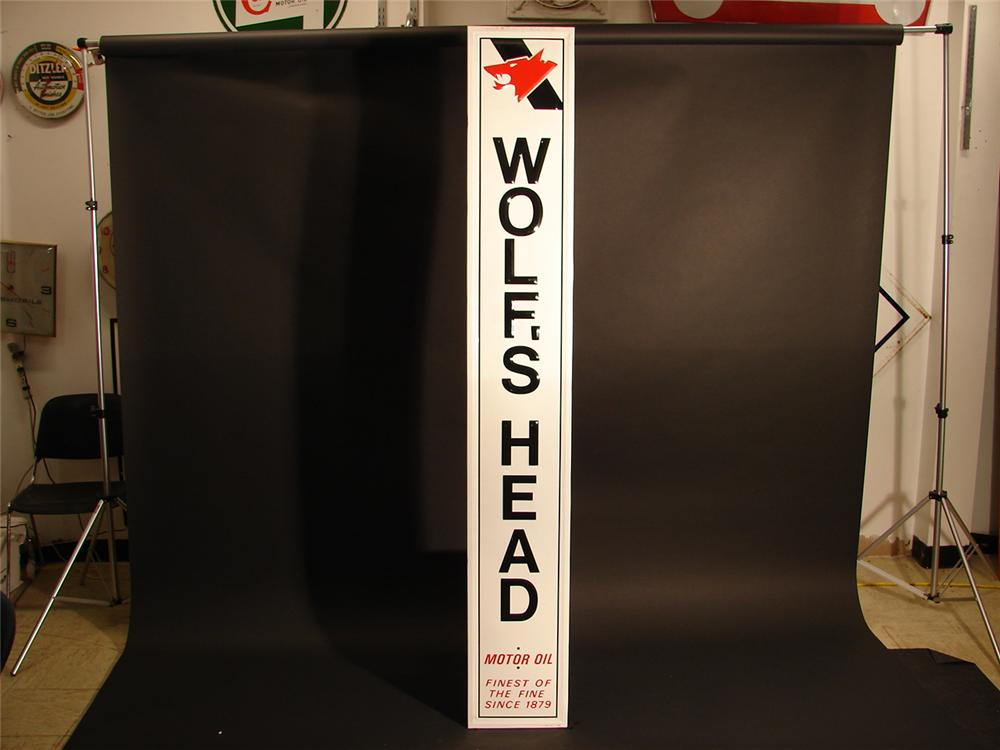 N.O.S. Wolfs Head Motor Oil self-framed tin vertical garage sign. - Front 3/4 - 63000