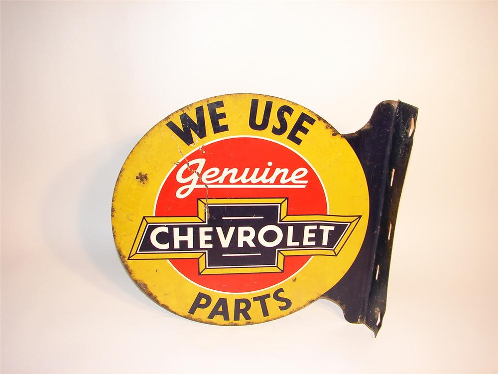 "1930s Chevrolet ""Genuine Parts"" die-cut tin dealership flange with patina. - Front 3/4 - 63060"