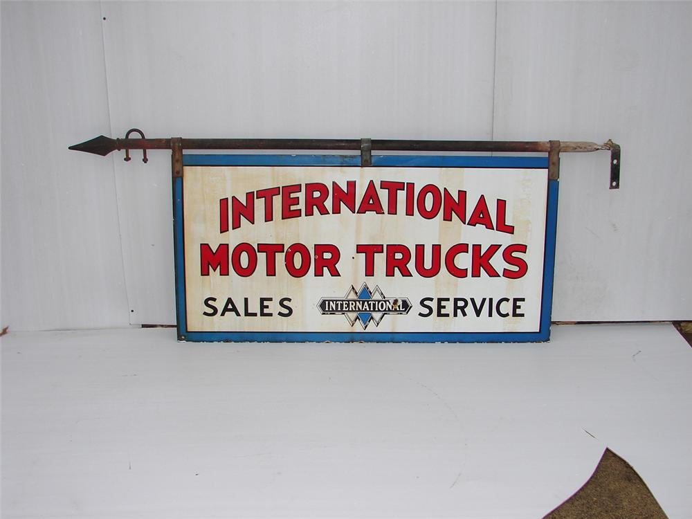1940s-50s International Motor Trucks double-sided porcelain dealership sign with original hanging bracket - Front 3/4 - 63086