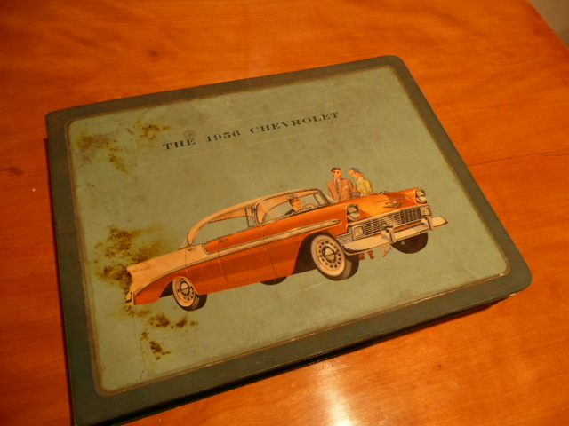 1956 Chevrolet showroom sales dealership book containing specs, paint charts and uppholstery samples. - Front 3/4 - 63137