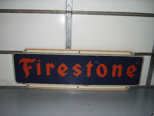 1950s Firestone Tires single-sided tin garage sign. - Front 3/4 - 63234