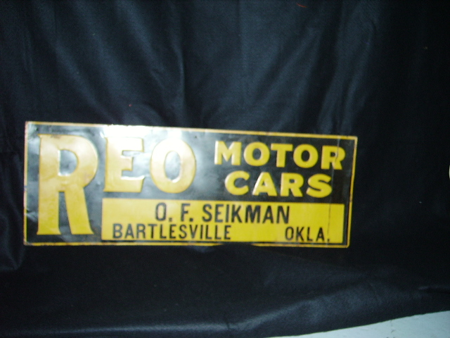 1930s REO Automobiles single-sided embossed tin dealership sign. - Front 3/4 - 63235