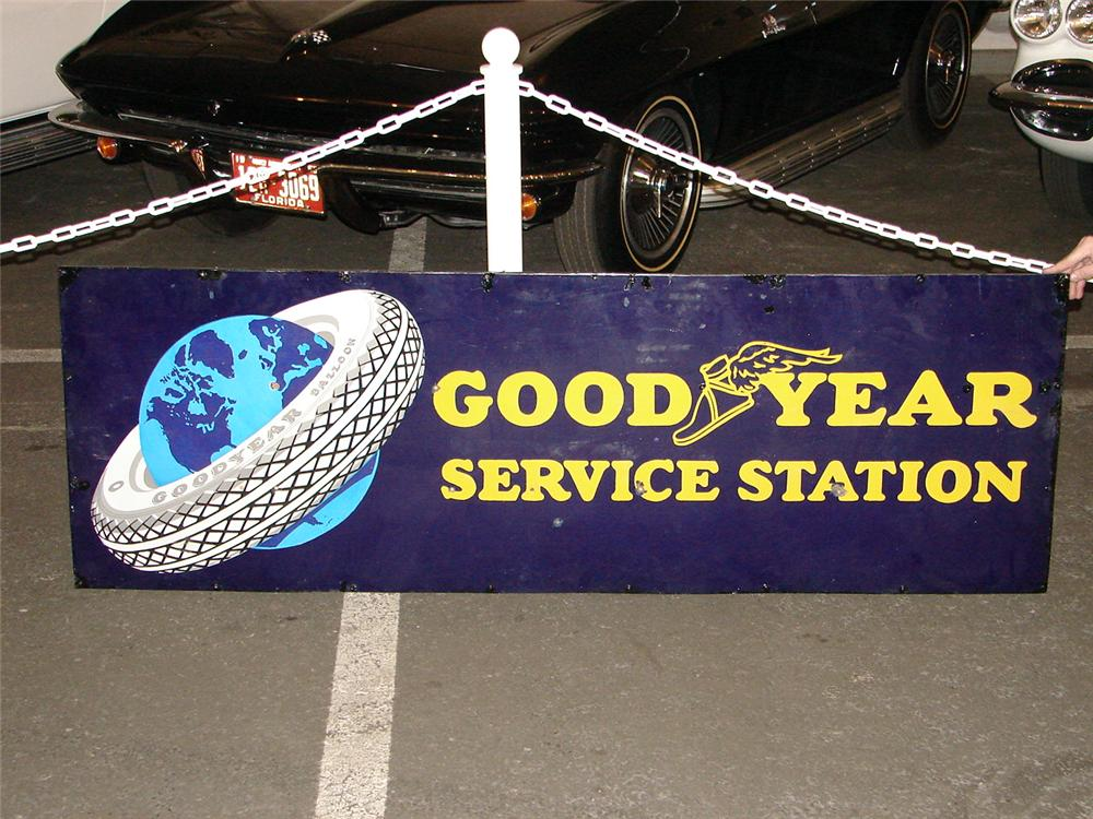 Stylish 1930s Goodyear Tires single-sided porcelain station sign with tire around world logo. - Front 3/4 - 63265