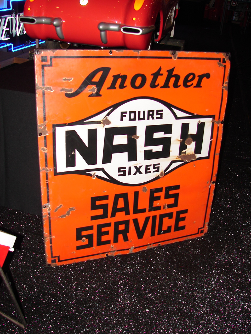1930s Nash Fours-Sixes single-sided porcelain dealership sign. - Front 3/4 - 63266