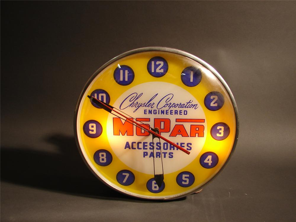 Highly desirable late 50s Mopar Accessories - Parts light-up station clock by Telechron. - Front 3/4 - 64495