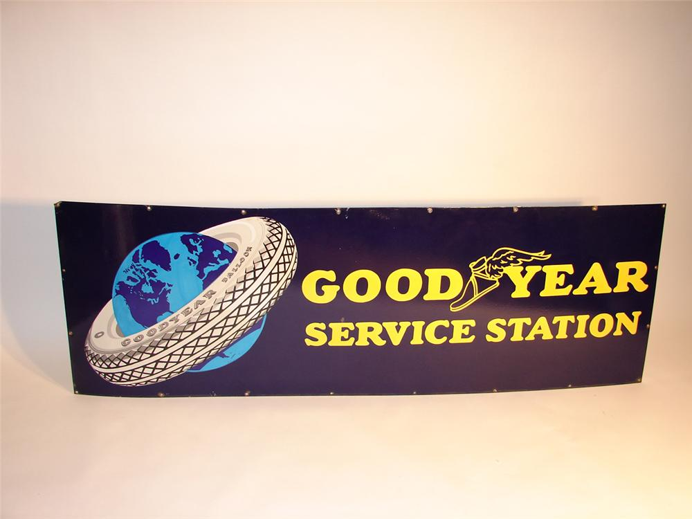 Spectacular 1930s Goodyear Service Station porcelain garage sign with tire around the globe logo. - Front 3/4 - 64581