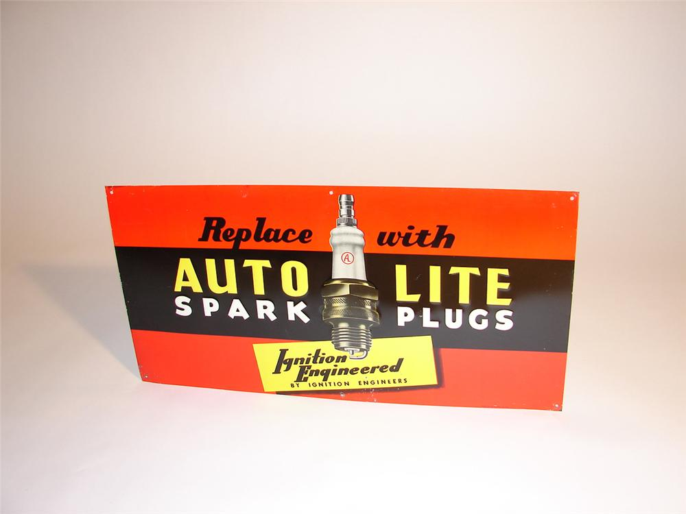 N.O.S. 1940s Auto Lite Spark Plugs embossed tin garage sign. - Front 3/4 - 64748