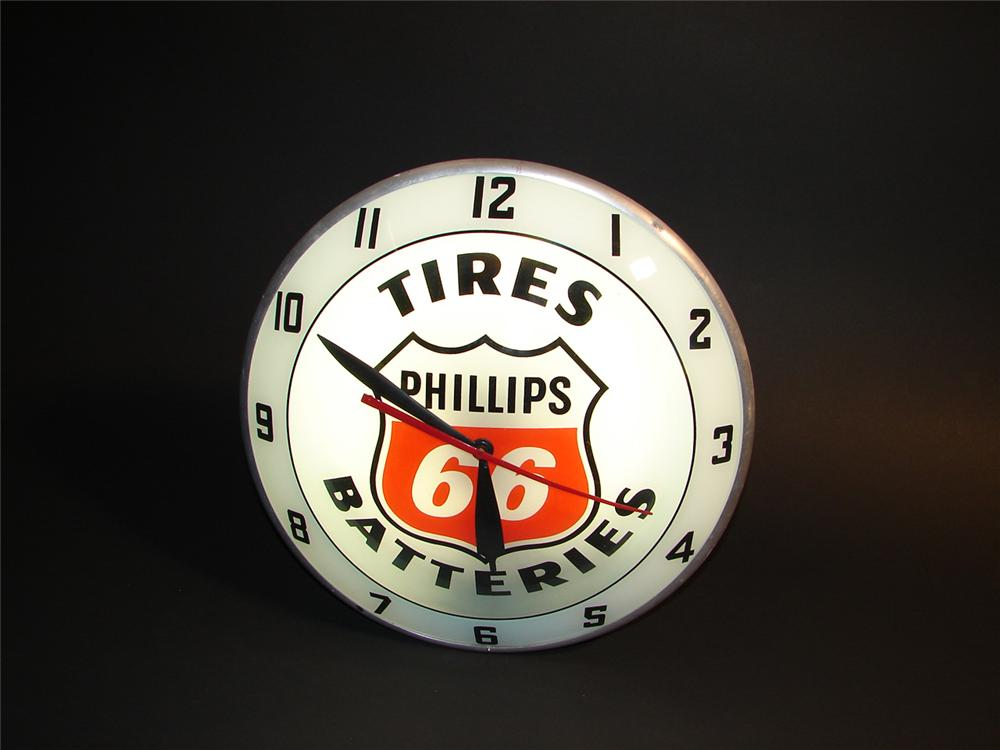 Outstanding Phillips 66 Tires and Batteries double-bubble light-up station clock. - Front 3/4 - 64763