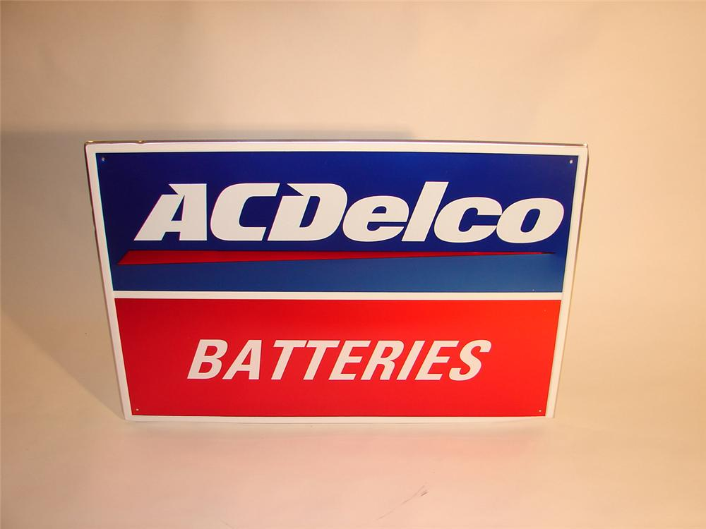 N.O.S. AC Delco Batteries single-sided tin dealership sign. - Front 3/4 - 64784