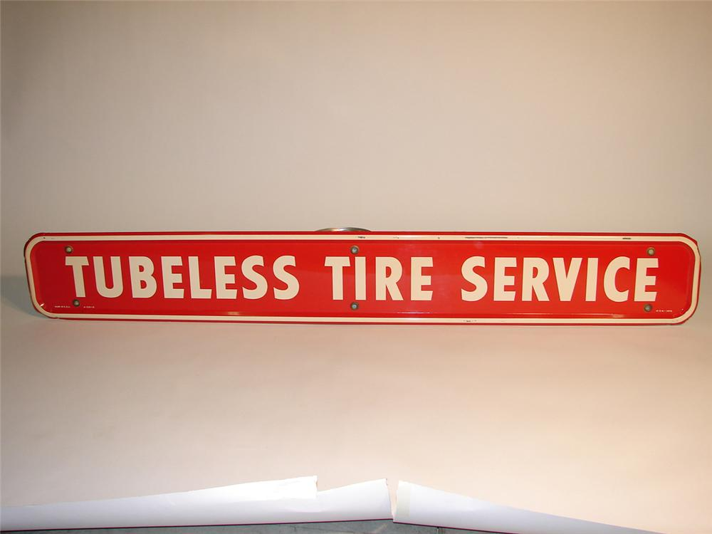 "N.O.S. 1950s Firestone ""Tubeless Tire Service Sign"" tin sign. - Front 3/4 - 64939"