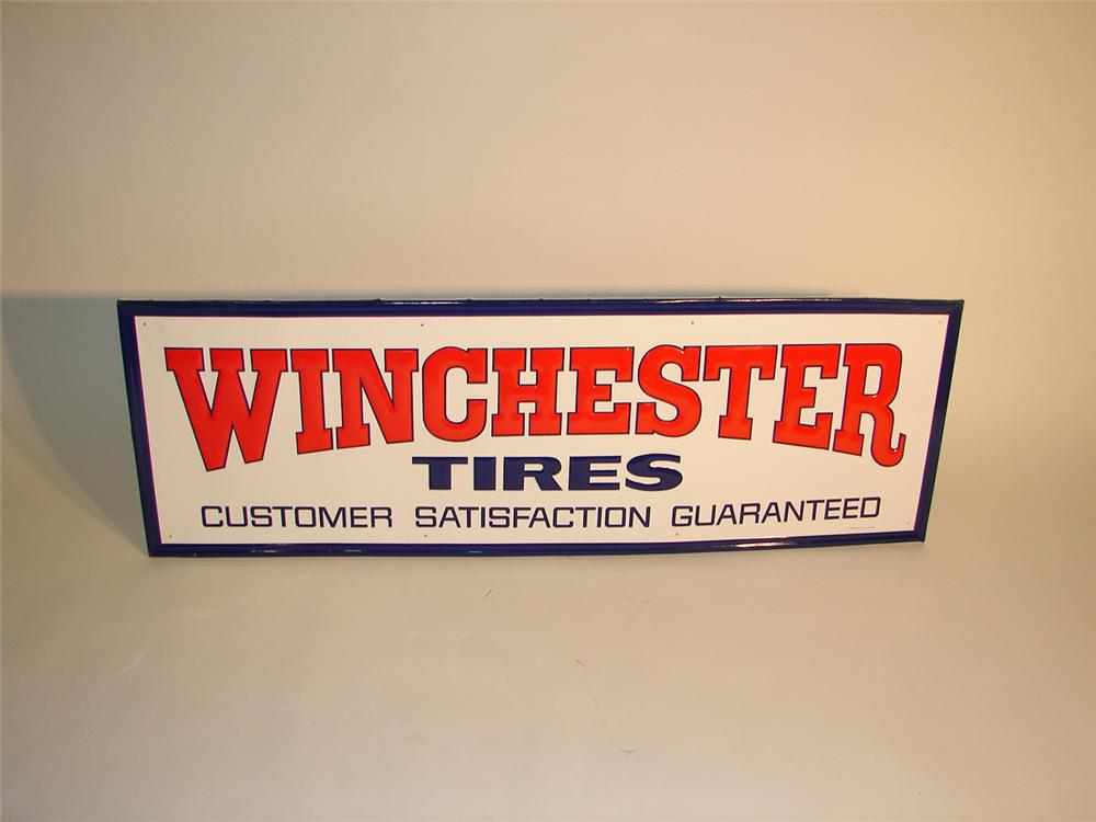 N.O.S. 1960s Winchester Tires embossed garage sign. - Front 3/4 - 64966