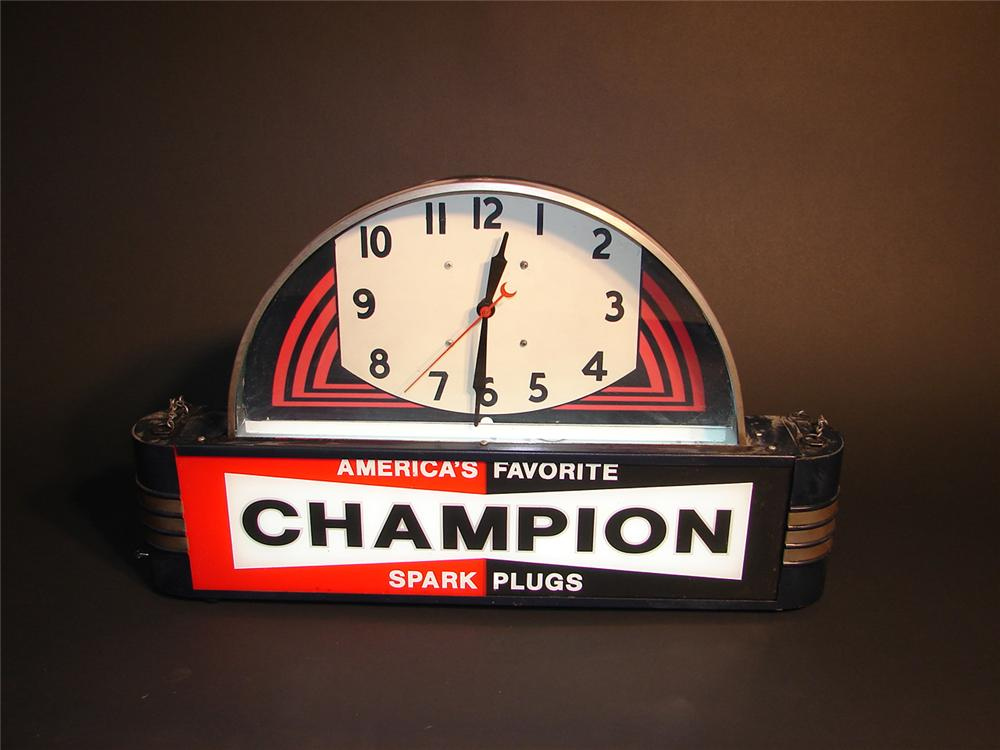 Magnificent 1930s Champion Spark Plugs art deco influenced light-up garage clock. - Front 3/4 - 64973