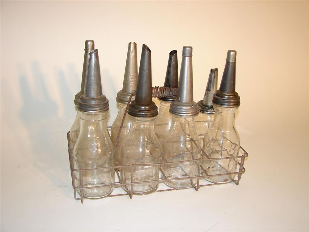 Rack of eight vintage service station oil bottles in rack. - Front 3/4 - 65361