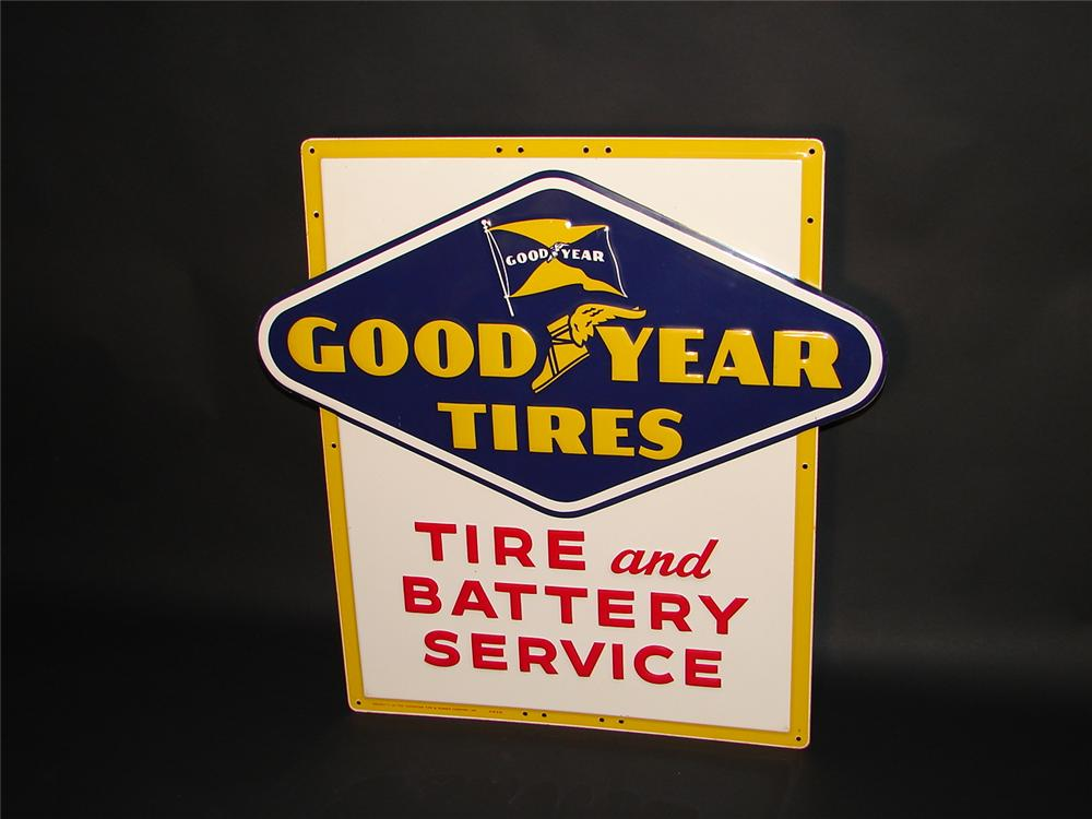 Unequaled N.O.S. 1954 Goodyear Tires and Battery Service die-cut tin garage sign. - Front 3/4 - 66394