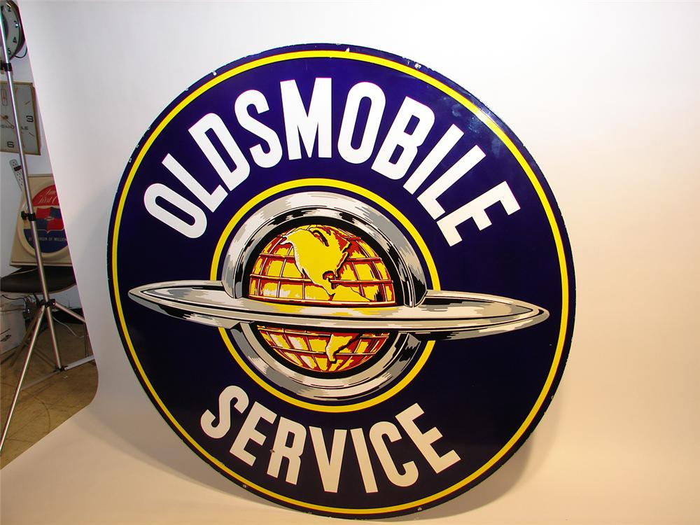 Splendid 1940s Oldsmobile double-sided porcelain dealership sign with globe logo. - Front 3/4 - 66397