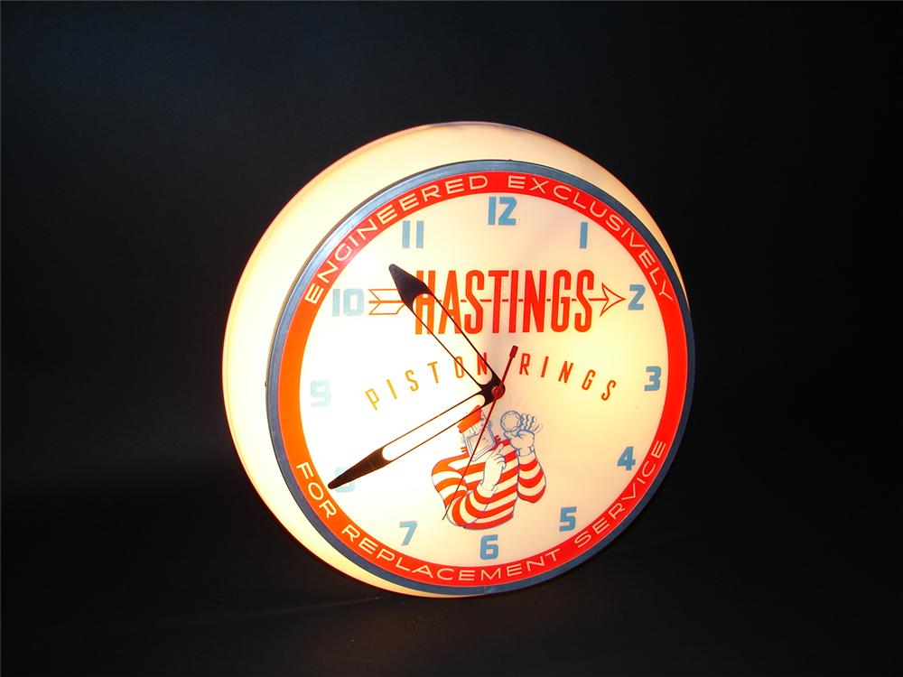 Choice 1950s Hastings Piston Rings light-up station clock. - Front 3/4 - 66432