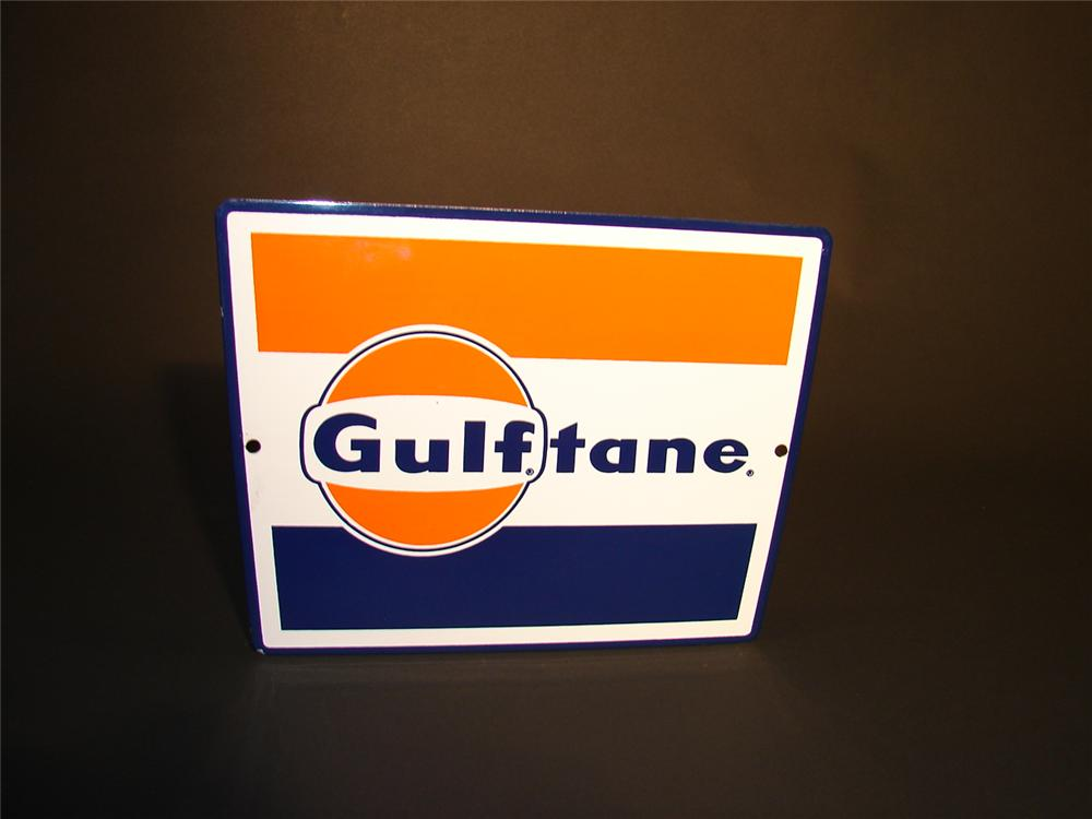 N.O.S. 1960s Gulftane porcelain pump plate sign. - Front 3/4 - 66549