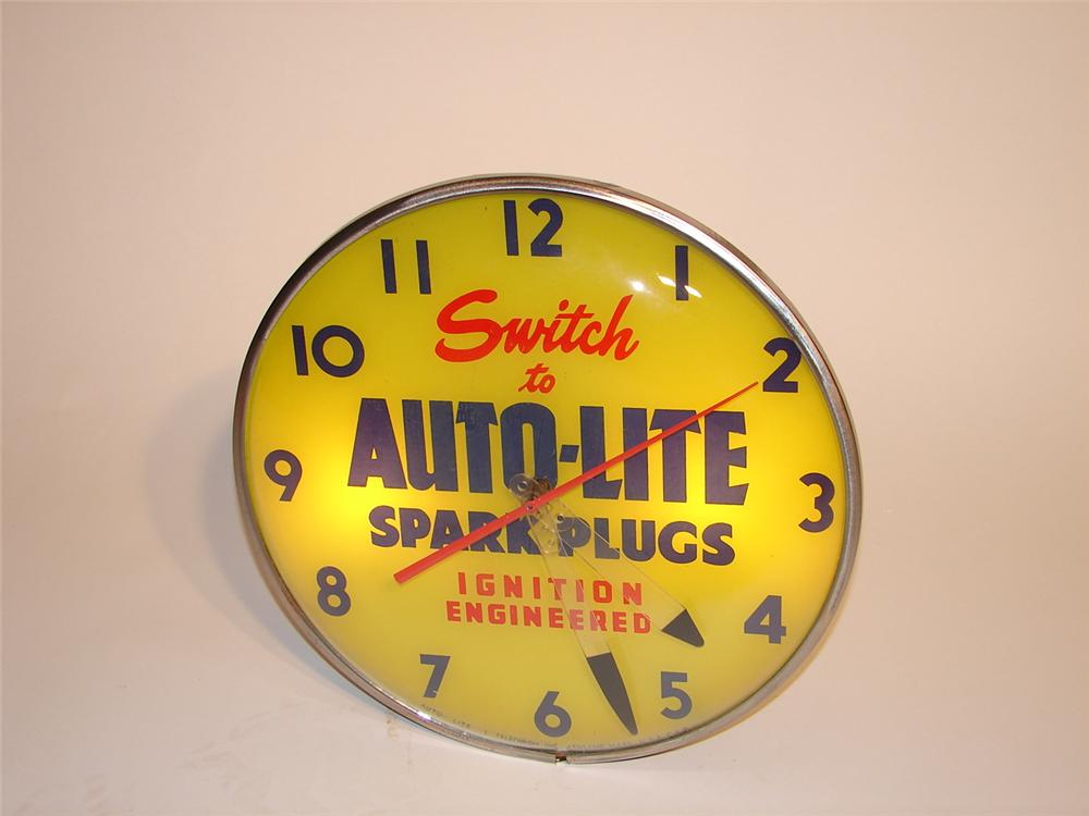 1950s Auto-Lite Spark Plugs light up clock by Telechron. - Front 3/4 - 66839