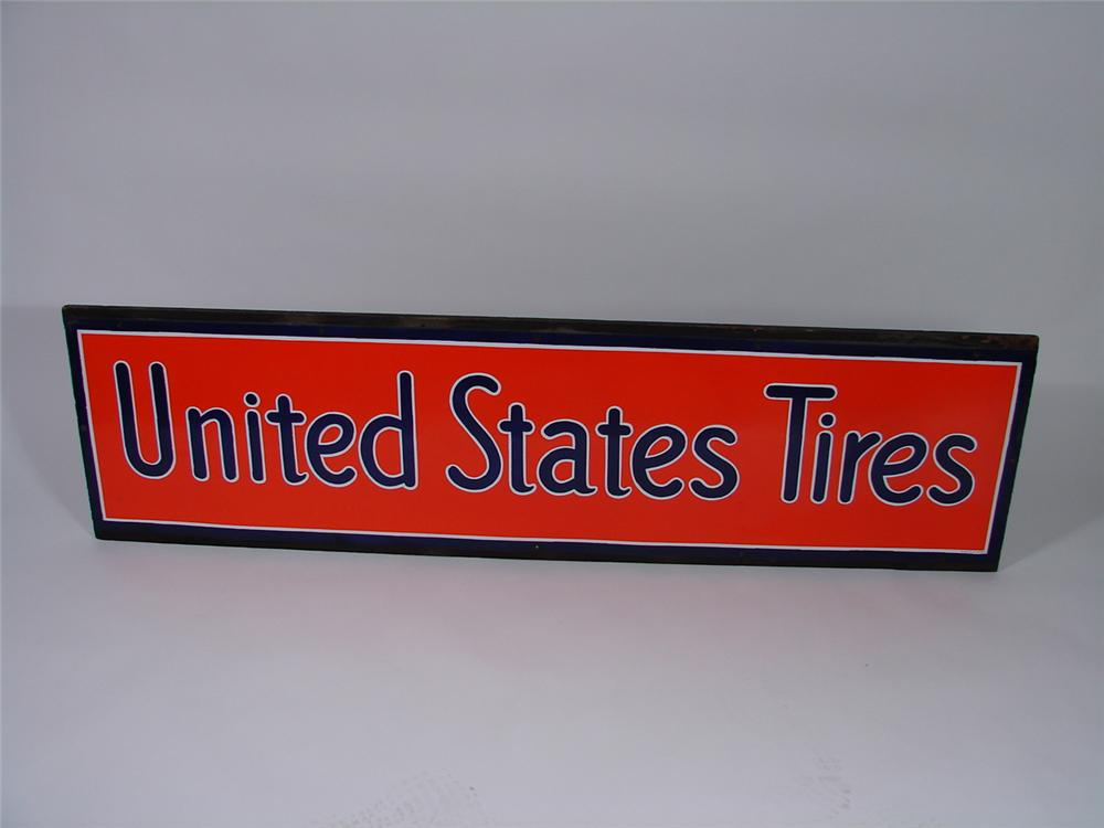 Remarkable N.O.S. late 1920s United State Tires horizontal porcelain garage sign still on the original wood frame. - Front 3/4 - 69333