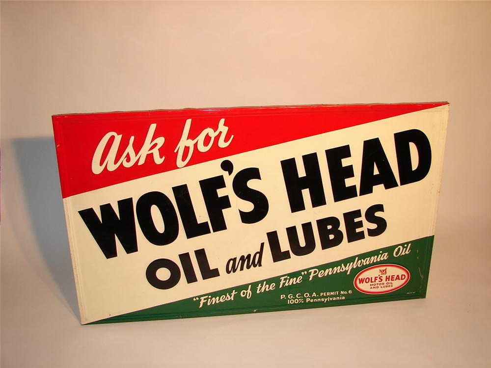 N.O.S. 1946 Wolfs Head Motor Oil self-framed tin garage sign. - Front 3/4 - 69335