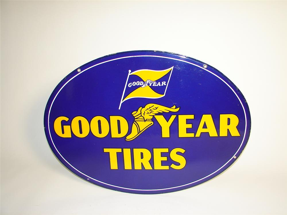 N.O.S. 1940s Goodyear Tires double-sided porcelain garage sign. - Front 3/4 - 71398