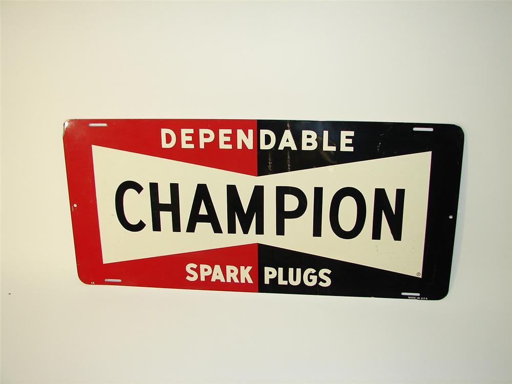 Extremely clean 1950s Champion Spark Plugs tin painted garage sign. - Front 3/4 - 71472