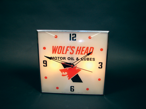 Sharp Wolfs Head Moter Oil glass faced light-up garage clock. - Front 3/4 - 71479