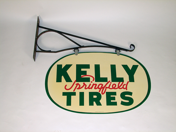 N.O.S. 1948 Kelly Tire double-sided tin garage sign still in the original box. - Front 3/4 - 72230