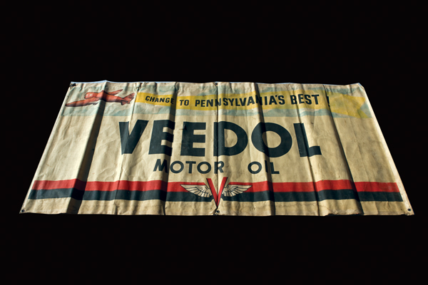 Circa 1940s Veedol Motor Oil canvas service station banner with aviation theme. - Front 3/4 - 72233
