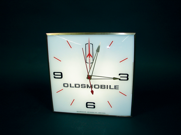 Scarce 1960s Oldsmobile glass faced light up dealership clock by Pam. Light and works perfectly. - Front 3/4 - 72235